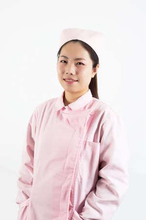 Young pretty Asian female nurse. Stock Photo - 18200857