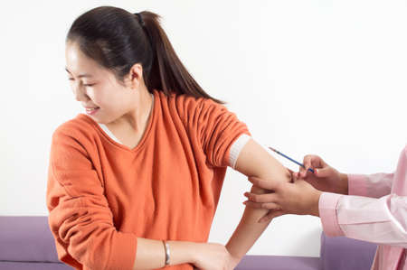 Girls endure the pain of injections Stock Photo - 18200844