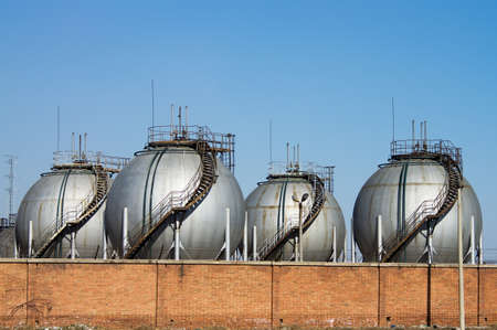 The silver huge storage tanks. photo