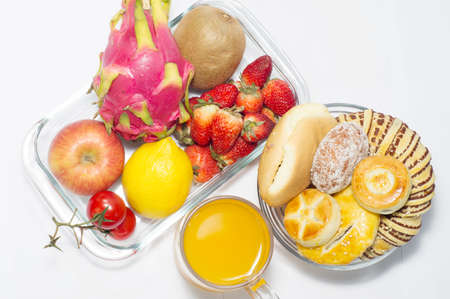 Many fresh fruits and bread, nutritious meals. photo