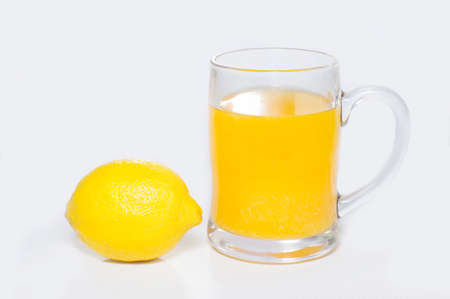 Close-up lemon and lemon juice isolated on white background photo