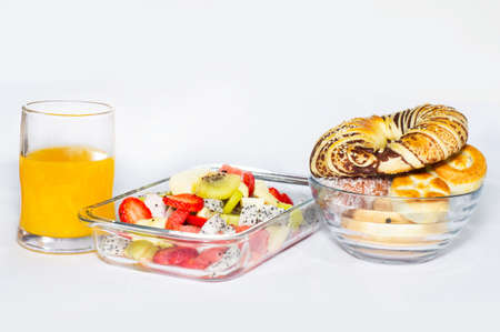 Fruit platter, bread and juice photo