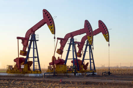 Work of oil pump jack on a oil field. Oil and gas industry.  Stock Photo