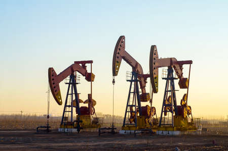 Work of oil pump jack on a oil field. Oil and gas industry.  photo