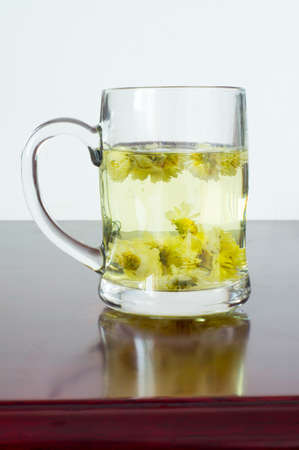 A cup of flower tea, from chrysanthemums photo
