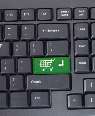 Green shopping key on the keyboard, close-up Stock Photo - 21641603