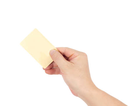 Businessmans hand in a golden holding blank paper business card, closeup isolated over white background photo