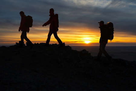 The three hikers walk trip, in the top of the sunrise