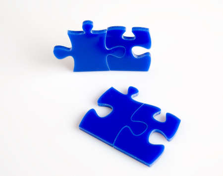 jig saw: Blue Jigsaw puzzles blocks isolated on a white background.