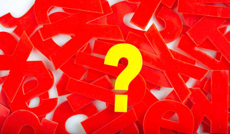 jumble: find Question mark in yellow letters on a background of red letter in a jumble or word search puzzle