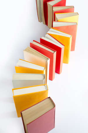 Close-up books standing isolated on white background