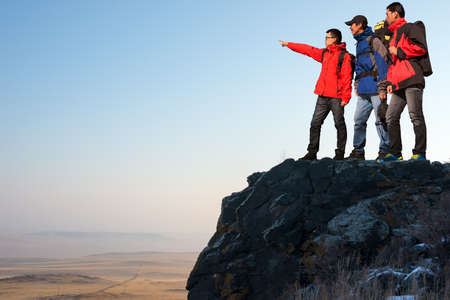 man climbing: Trekking in mountains, greet the morning sun