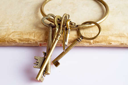 Ancient books and vintage keys isolated on white background photo