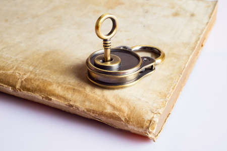 Retro lock and key at the ancient book photo