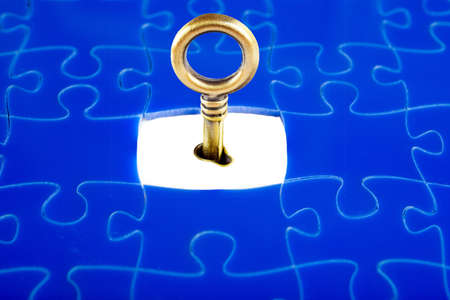 Jigsaw Puzzle with the missing piece, with a key to open photo