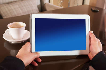Digital tablet with blue screen in coffee shop photo