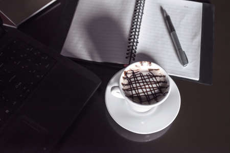 Tablet PC with fresh cup of coffee, dark tone  photo