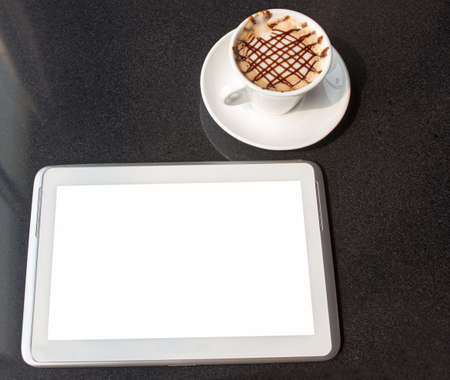 Tablet PC with fresh cup of coffee, view from above photo