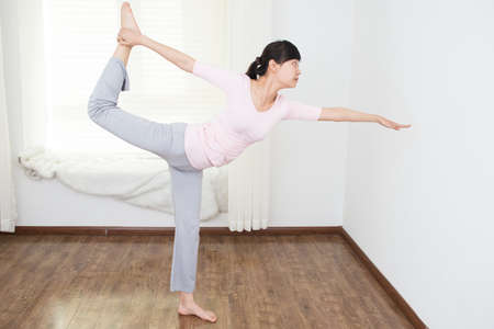 Beautiful Asian women to practice yoga in the room photo
