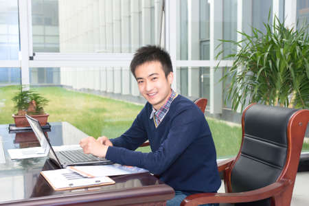 internships: Asian young people in business training, smiling for the camera