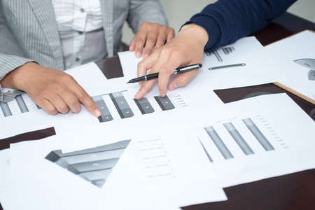 Closeup business people fingers, analysis diagram is discussed in this paper photo