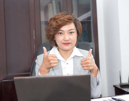 Business woman thumbs up with both hands, praised the success