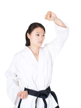 Portrait of a girl practicing taekwondo. Hand fist  Stock Photo