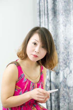 Beautiful woman with smartphone at home. Asian Girl photo