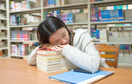 The fatigue of the female students. Sleeping in the library