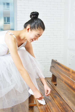 lace up: Female ballet dancer elegant lace up ones shoes Stock Photo