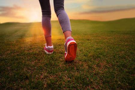 wellness woman: Rear view of a girl running
