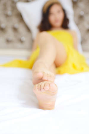 bed feet: Asian girls lying in bed, feet macro