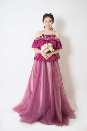 bride dress: Purple elegance Bride in wedding dress. The Hand rised up with the bouquet. Stock Photo