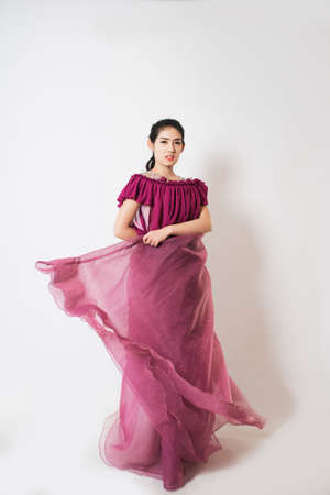 dress blowing in the wind: The beautiful girl with purple dress skirt.