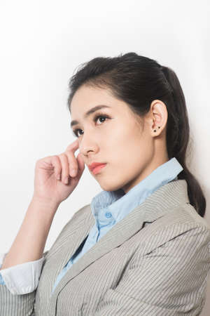preety: Portrait of a young attractive business woman thinking with hand on chin