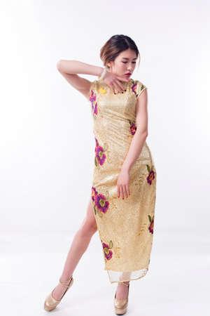 Chinese girl wearing cheongsam . Stock Photo
