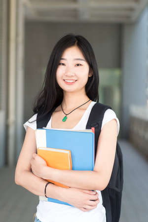 Portrait of a Asian college student at campus Banco de Imagens