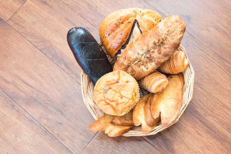 Different types of bread on a wooden table