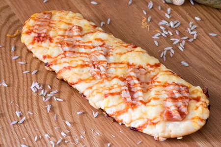 Close-up of delicious fresh ham pizza