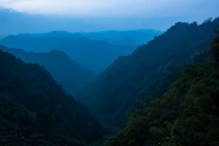 The mountains loom over each other. In Sichuan province, China.