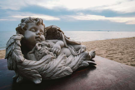 baby angel: Baby angel statue decorated by the beach