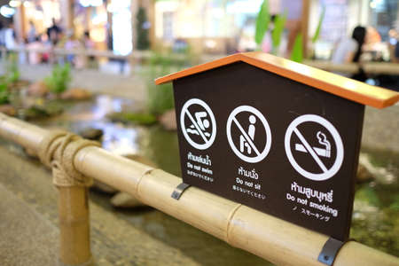 sign post: Prohibit sign post on the bamboo fence Stock Photo