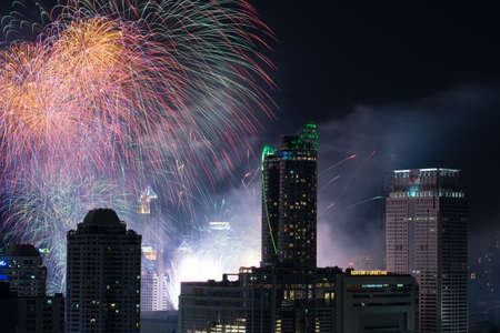 held down: Bangkok, Thailand - Jan 1, 2016: Central World, the biggest shopping mall in Bangkok, held a New Year count down event and shot fireworks at 00.00 AM on Jan 1, 2016 Editorial