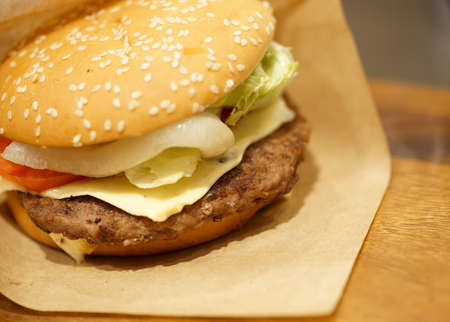 onion: Beef burger on wood table, close-up image, focus on the beef Foto de archivo