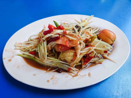 somtum: Somtum, papaya salad with crab, spicy local Thai food dish on blue table