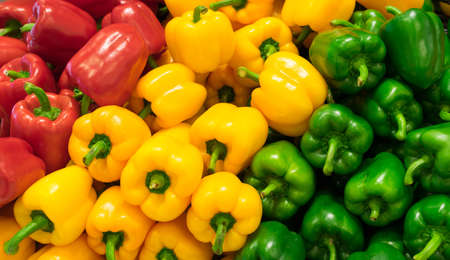 Red, yellow, and green bell peppers capsicum background