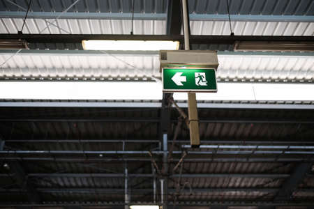 green arrow: Exit sign post with clipping path