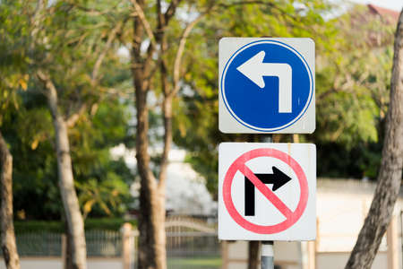 turn left sign: Turn left, and no right turn traffic sign post with clipping path Stock Photo