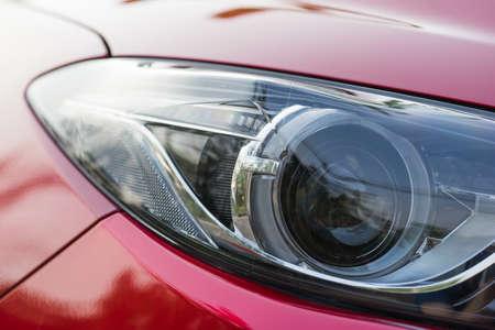 xenon: Xenon projector headlight of a red car