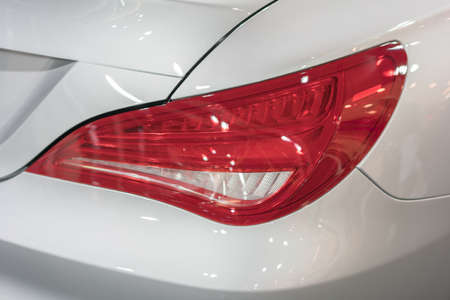 taillight: Tail light of a silver luxury car Stock Photo